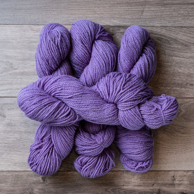 Mauve skeins of yarn.