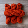 Orange Burnt skeins of yarn.