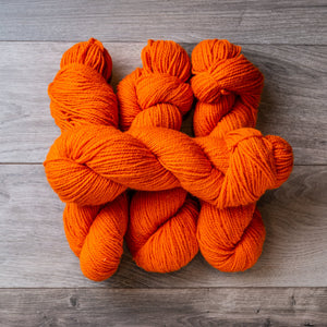 Orange skeins of yarn.