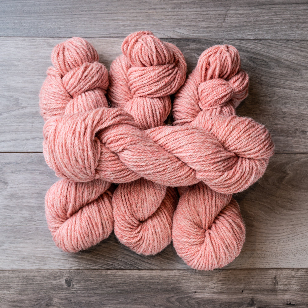 Pink Tweed skeins of yarn.