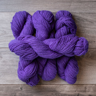 Purple skeins of yarn.