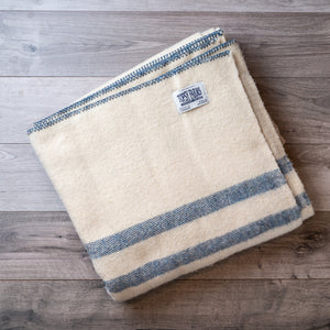 Blue heather striped queen blanket made of natural wool.
