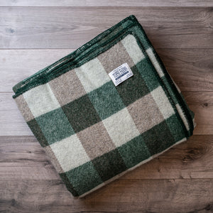 Hunter green and grey queen blanket made of natural wool.