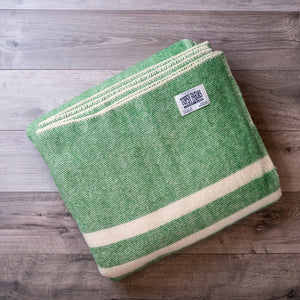 Kelly green queen blanket made of natural wool.