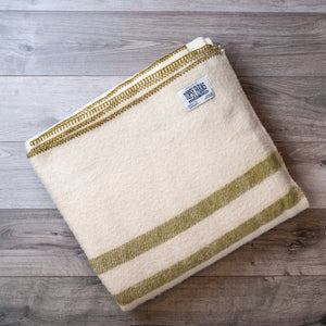Folded wool blanket in natural white with 2 olive green stripes