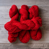 Red skeins of yarn.