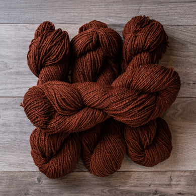 Rust Dark skeins of yarn.
