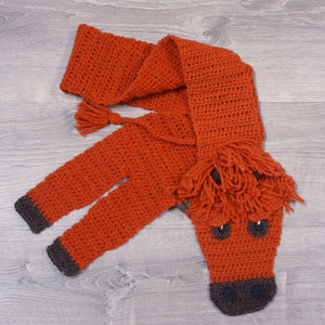 Knitted wool highland cow scarf, made with Topsy Farms' wool