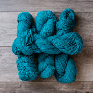 Turquoise skeins of yarn.