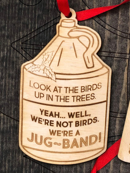 """Look at the birds up in the trees. Yeah Well, we're not birds. We're a JUG-BAND!"" in jug shape."