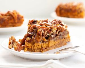 Dulce de Leche Pecan Pie is a dulce de leche cheesecake layered with toasted pecans and a pecan pie filling, all topped and baked with more pecan