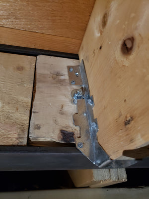 Contractor cut joist hangers to make them fit