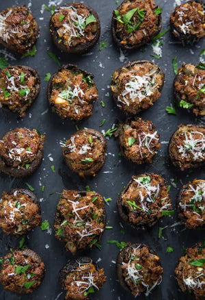 An easy and elegant recipe for Smoked Sausage Stuffed Mushrooms cooked on your smoker (or oven)