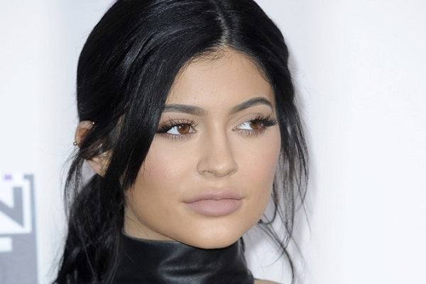 Kylie Jenner Channels Sultry Easter Bunny In Skintight Dress & Gold Bunny Ears