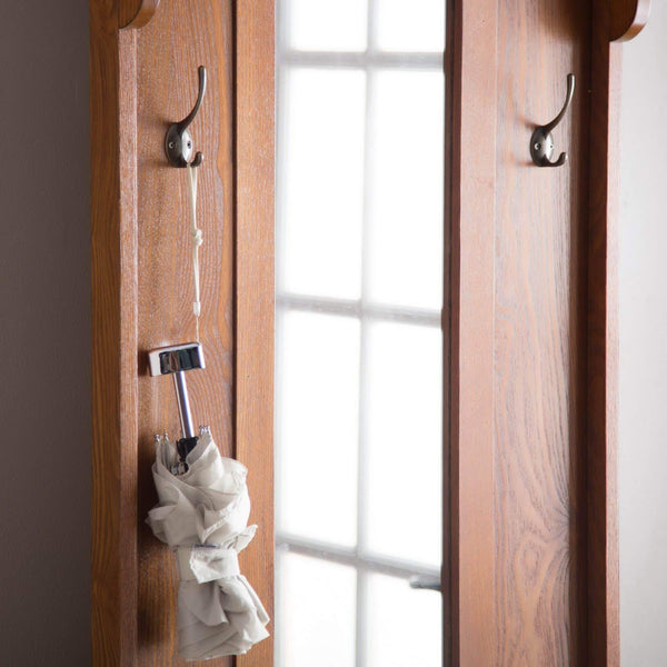 Best wooden entryway tall hall tree bench coat and hat rack with mirror in oak finish with 2 double hooks in antique bronze storage bench base and a full length central mirror