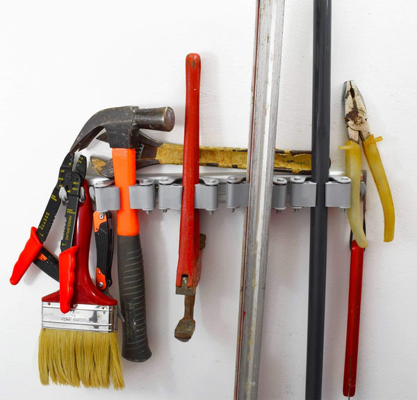 Shop not yet another mop broom holder clips hold everything better than rollers 4 sliding grippers and 4 hooks wall mount on aluminum rack by 2 screws only tools organizer for garden garage or closet