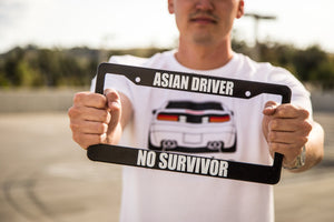 Man Holding ASIAN DRIVER NO SURVIVOR Meme Inspired License Plate Frame