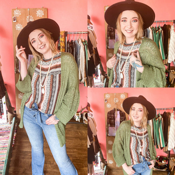Fall outfit featuring light wash flare jeans, printed short sleeve and olive cardigan