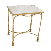 A trendy rectangular side table with golden rope themed metal legs with tassel feet topped with marble