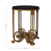 A unique 'Art Deco' style side table in an antique gold finish topped with a round black granite