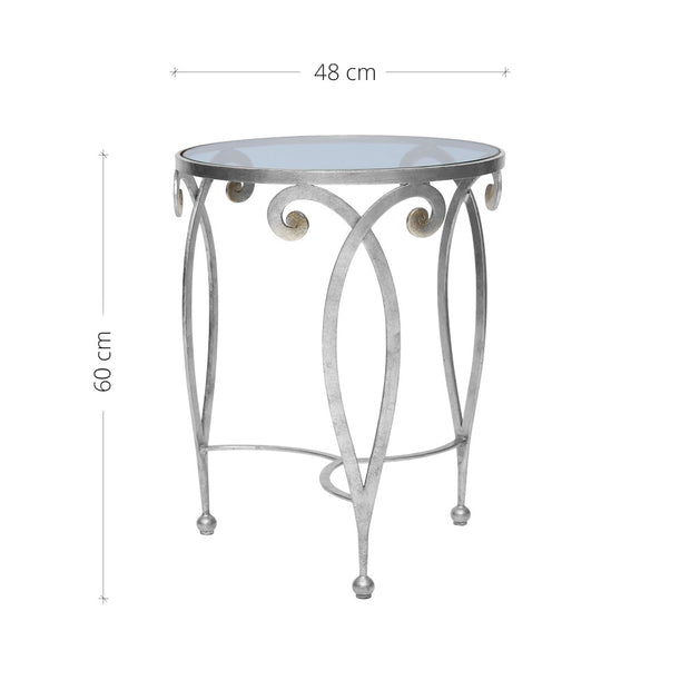 An exquisite silver end table made of metal scrolls topped with a clear round glass