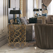 A contemporary living room exhibiting unique accent tables comprised of golden metallic rings topped with clear glass