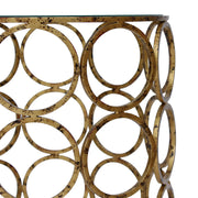 Antique gold metal rings welded side by side to create a base for a unique accent table
