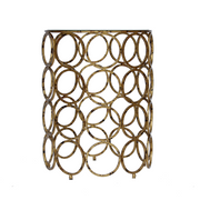 Forty golden iron rings joined together to form a unique looking side table