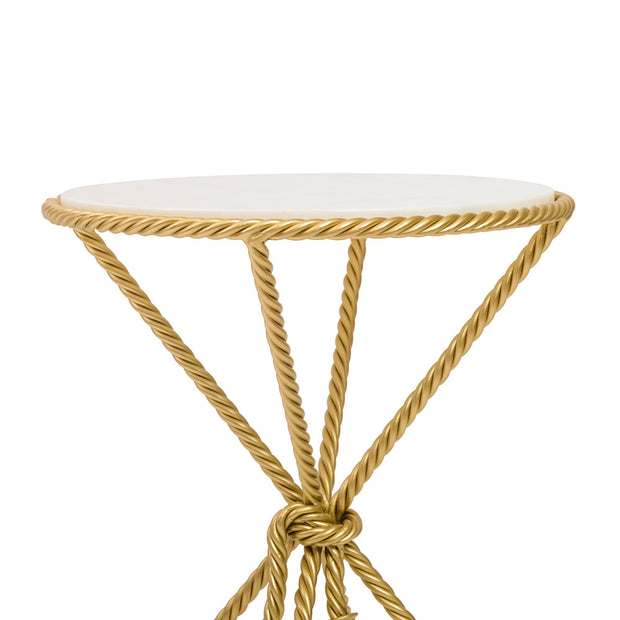 Top portion of a rope themed round table in golden color and marble top
