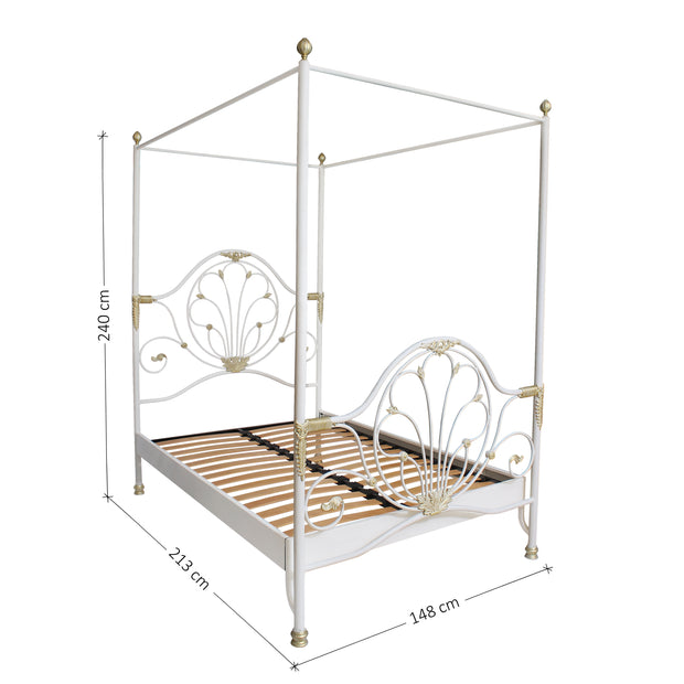 A classical metal single canopy bed with large scrolls and motifs, painted in a white and gold finish; with annotated dimensions