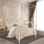 A contemporary wrought iron single canopy bed with large scrolls and leaf motifs, painted in a white and gold finish
