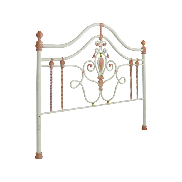 Wrought iron headboard for girls single bed with scrolls, leaves and motifs painted in white, pink and hints of gold