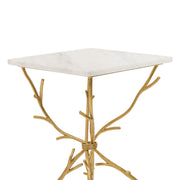 Top portion of a unique accent table with golden legs that look like branches