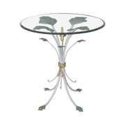 A novelty end table inspired by branches and leaves with a transparent glass top