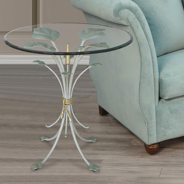 Luxurious side table with base resembling branches inspired by nature; topped with clear glass