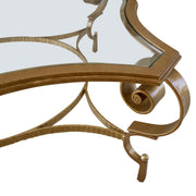 Curved hand-forged metal legs pf luxury coffee table with curved glass top