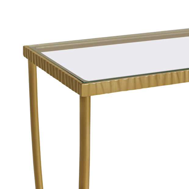 Close up of unique styled console table with simple golden curved legs and a clear glass top