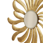Close up shot of a golden mirror inspired by the rays of the sun in a golden leaf finish