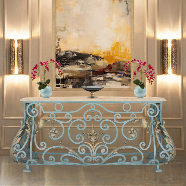 A unique console with a classical blue and gold base topped with a beige marble in a luxurious living area