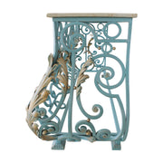 Side view of a classical console base made up of blue wrought iron scrolls and gold leaves