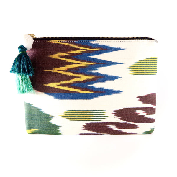 Each one of the little Ananya Silk Ikat Pouches is unique - no pattern is the same. They come with a padded lining that is made out of a hand-blockprinted fabric in contrast to the colours of the ikat and are having an extra side pocket with zip.   It is also the perfect holiday bag - the size is ideal for passport and documents for the journey and big enough for lipstick and mobile phone to get you through the night. Designed by us and produced by a small family owned business in Jaipur.