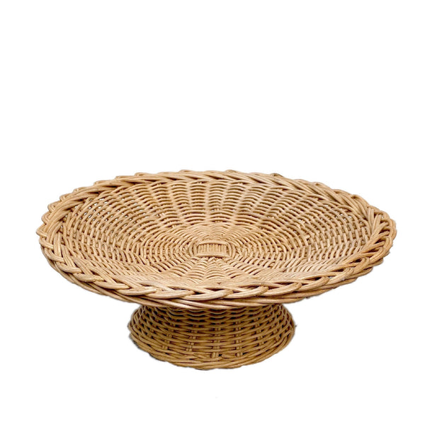 Belanak Pedestal Bowl. Our Belanak Pedestal Bowl is woven by hand by our team of artisans in Java, Indonesia. The rattan has a beautiful warm honey hue and is the perfect addition to any table setting, which can be used in various ways. It's perfect as a bread or fruit bowl but equally nice to display other items such as shells or jewellery.