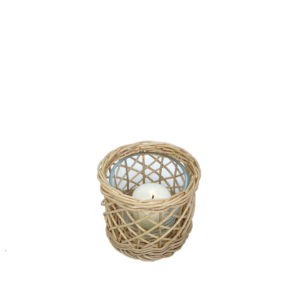 Belanak Wicker Hurricane Small. These small wicker hurricanes can be used in multiple ways. Group the two different sizes with candles on the dinner or side table or alternatively use them as vases with fresh cut blossoms.  The glass insert can be removed for easy cleaning in the dishwasher. Made by hand of woven rattan by our artisans in Java, Indonesia.