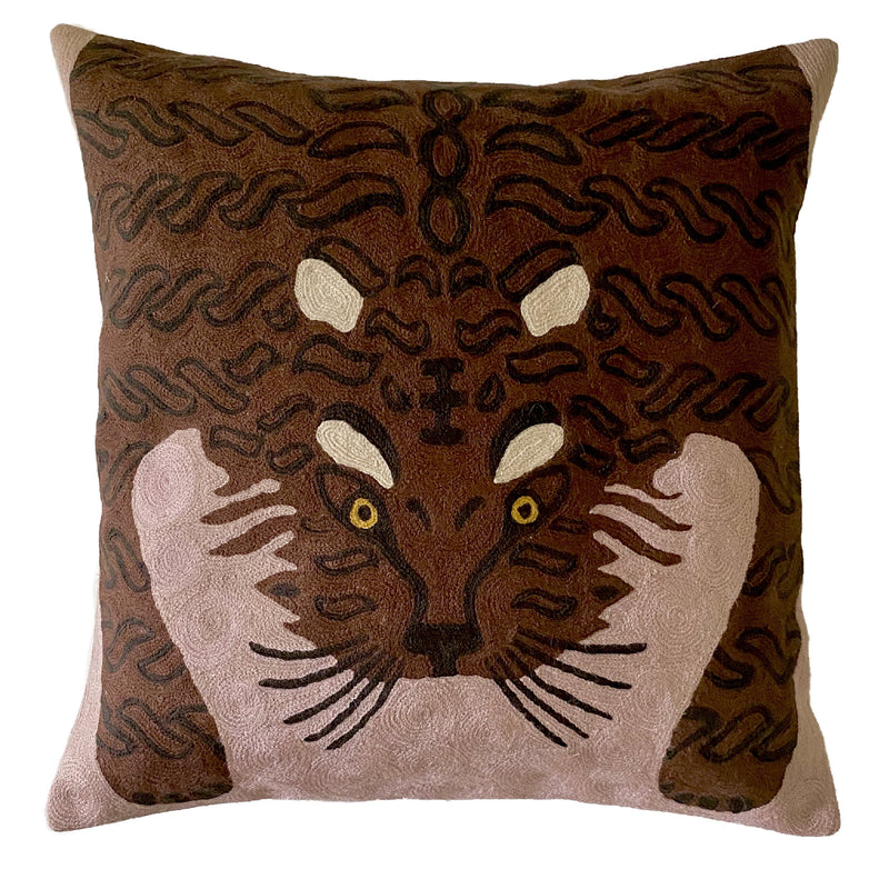 Bengal Tiger Cushion Cover Dusty Pink. Each cover is made by hand by skilled artisans in Kashmir, the most northern part of India. Using a technique called chainstitch, colourful pure wool yarn is stitched by hook through cotton. Each cover takes up to a week to make.  We are stocking these beautiful cushion covers in a selection of bold colours in very small quantities. This one is a brown tiger on dusty-pink background.