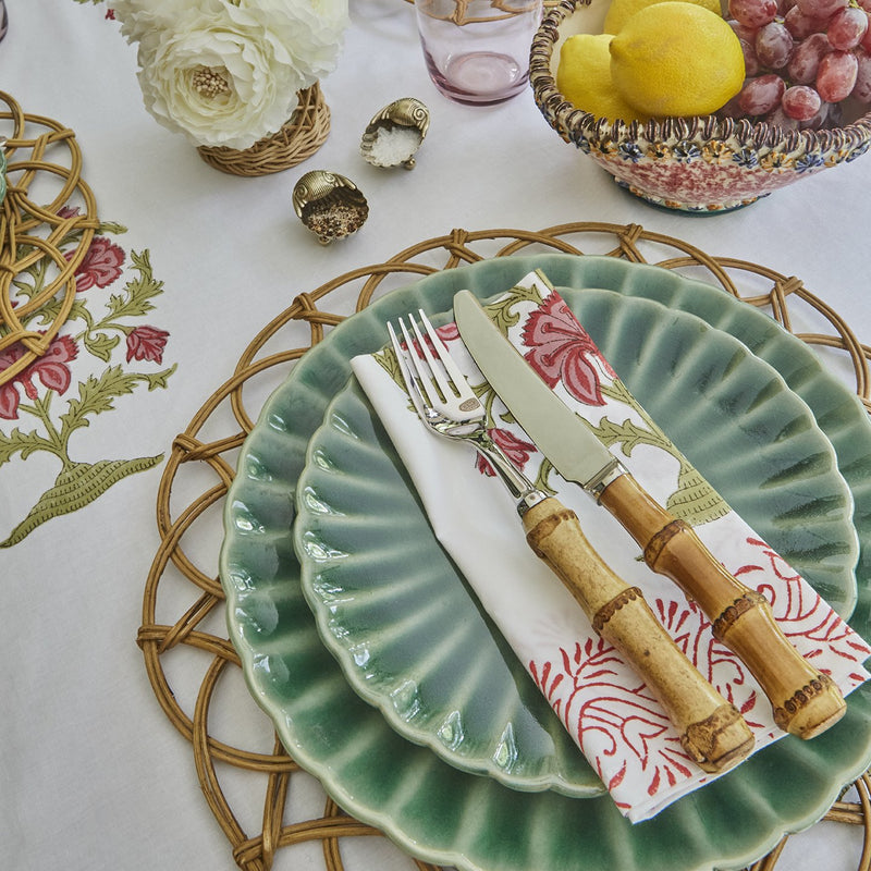 Block Print Tablecloth and Napkin Set in Green and Pink (Floral). These beautiful block printed table cloths with matching napkins come in a set for 6 to 8 people. The floral patterns are printed by hand in multiple layers on a very high quality percale cotton by artisans in Jaipur, India. This set is kept in shades of light and dark pink and sage green. It looks stunning together with our Lotus ceramics, Belanak place mats and hurricanes as well as the tropical bamboo cutlery.