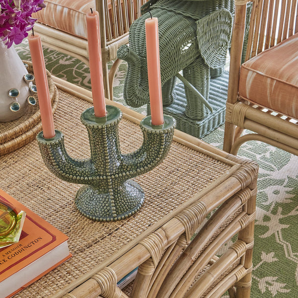 A stunning ceramic candelabra with a bold seagrass glazing. Pair it with a few of our coloured candles and come shells for a true tropical touch on your dinner- or console table.  Our ceramics are all made by hand by a small family-owned manufactory close to Chiangmai in Thailand.