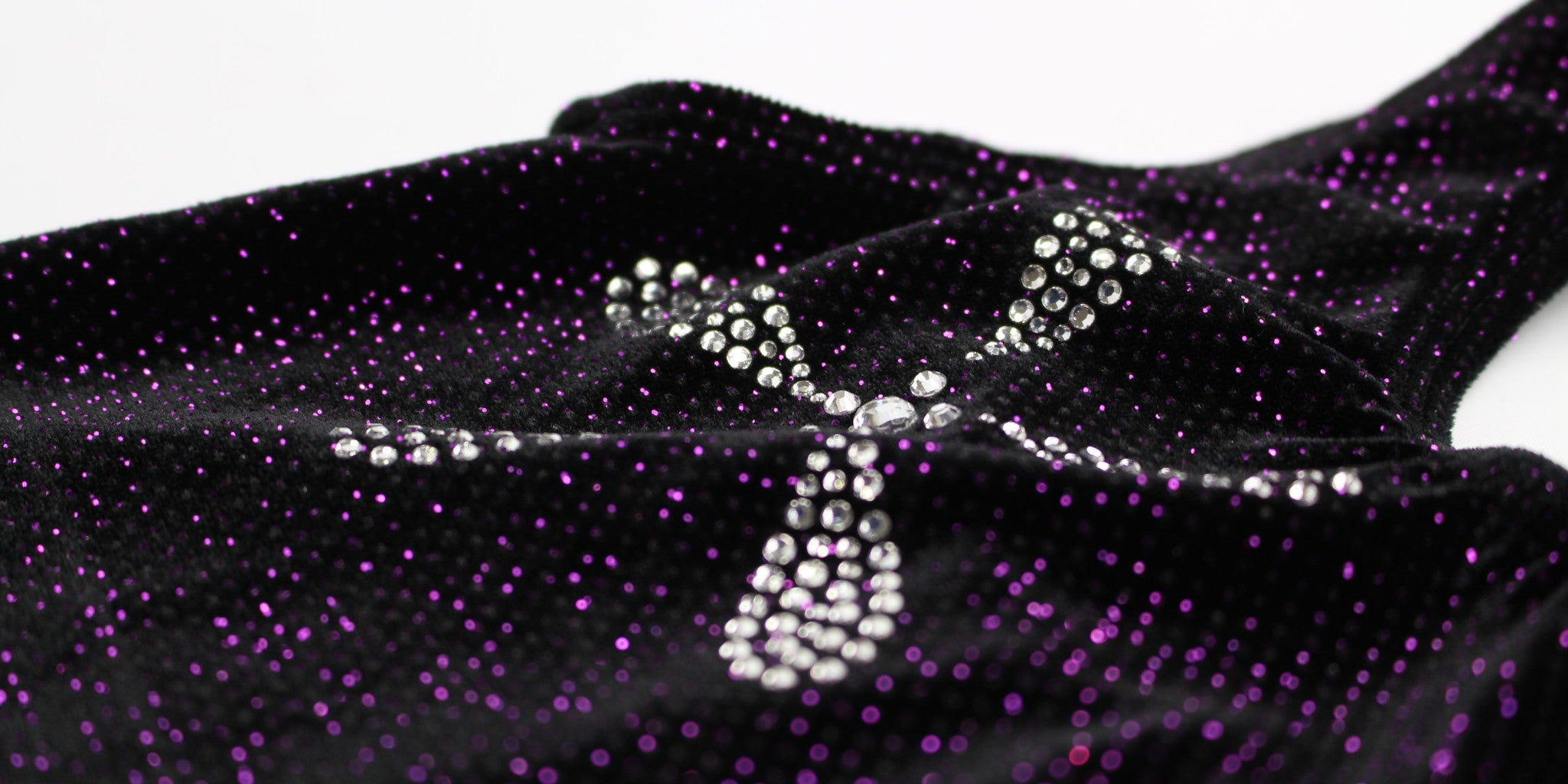 Gorgeous K-Lee Designs gymnastics leotard in black velvet with purple sparkles made and designed in Brisbane Australia