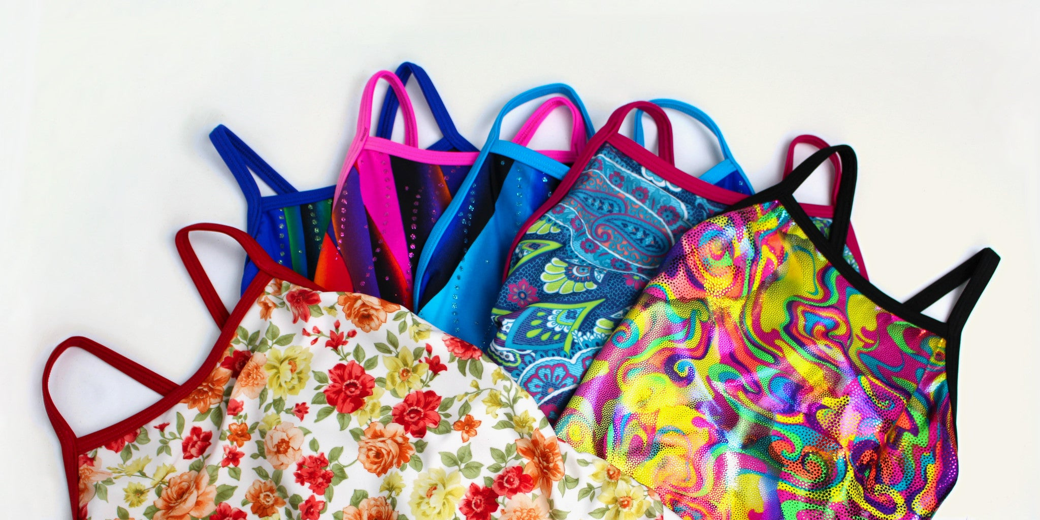 Variety of colourful and print girls' swimsuits made and designed in Brisbane Australia