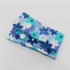Ear saver button headband in floral print in shades of blue