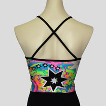 Load image into Gallery viewer, Back of the retro multi-burst crop top with crossover black straps along the upper back